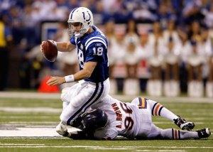 Alex Brown sacks Peyton Manning